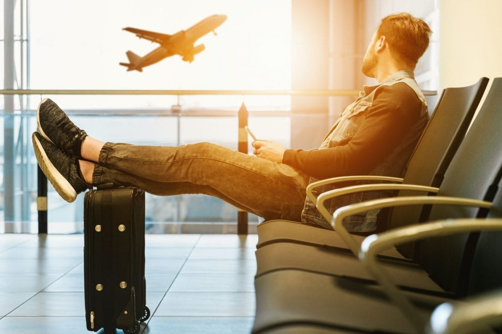 Man waiting to board airplane, for flying with a peanut allergy